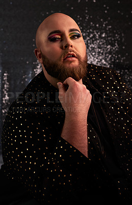 Buy stock photo Shot of a young man wearing theatrical makeup in a studio