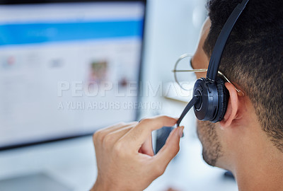 Buy stock photo Shot of an anonymous call center worker at their office