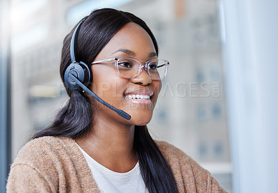Buy stock photo Shot of a businesswoman sitting at her desk in a call center office