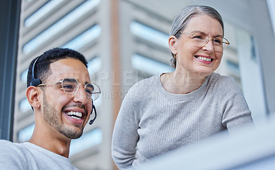 Buy stock photo Shot of a male businessman with his female boss in his office