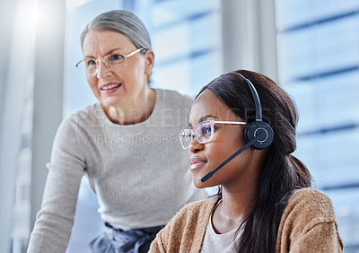 Buy stock photo Shot of a young businesswoman in her office with her senior manager