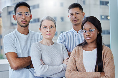 Buy stock photo Shot of a diverse team of coworkers together in their office at work