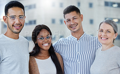 Buy stock photo Shot of a diverse group of work colleagues together in their office