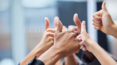 Buy stock photo Shot of  a group of coworkers with their arms raised in the thumbs up gesture