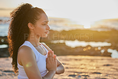 Buy stock photo Cropped shot of an attractive young woman meditating on the beach