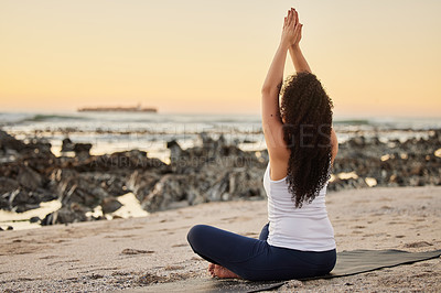Buy stock photo Rearview shot of an unrecognizable young woman practicing yoga on the beach