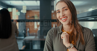 Buy stock photo Shot of a young businesswoman standing in her office