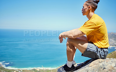 Buy stock photo Shot of a young man sitting down to enjoy the view during a hike