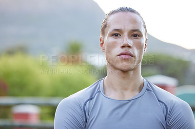 Buy stock photo Shot of a young man taking a break during his workout