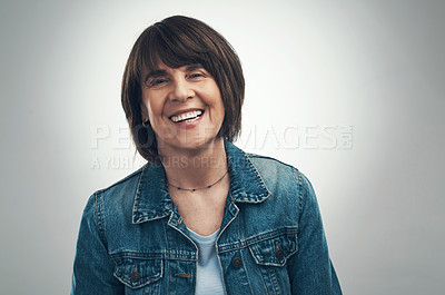 Buy stock photo Studio portrait of a senior woman standing against a grey background