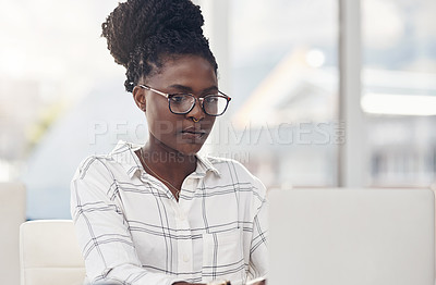 Buy stock photo Cropped shot of an attractive young businesswoman working in her office