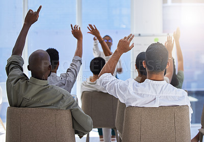 Buy stock photo Shot of a unrecognizable group of people lifting their hands at a work seminar in a modern office