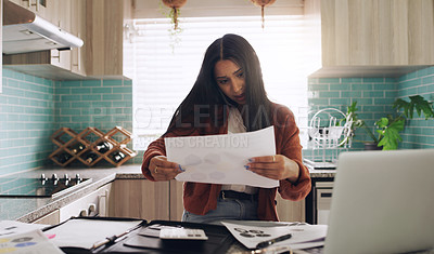 Buy stock photo Shot of a young businesswoman taking a phone call while working at home