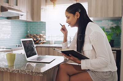 Buy stock photo Shot of a young businesswoman attending a virtual meeting at home