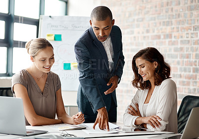 Buy stock photo Shot of a diverse group of businesspeople having a meeting in the office during the day