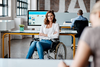 Buy stock photo Portrait of a young businesswoman in a wheelchair working in an office
