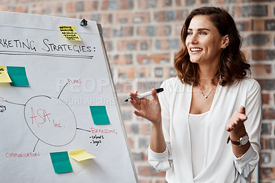 Buy stock photo Shot of a young businesswoman presenting notes on a whiteboard in an office