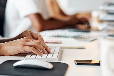 Buy stock photo Shot of an unrecognisable businesswoman using a computer in a modern office