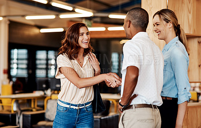 Buy stock photo Shot of a young businesswoman shaking hands with a colleague during a meeting in a modern office