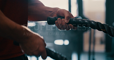 Buy stock photo Cropped shot of a man doing heavy rope training at the gym