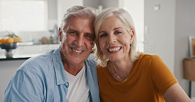 Buy stock photo Shot of a mature couple sitting together and bonding during a day at home
