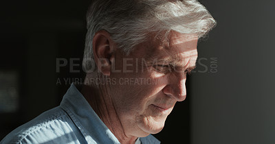 Buy stock photo Shot of a mature man standing alone in a dark room at home and feeling depressed