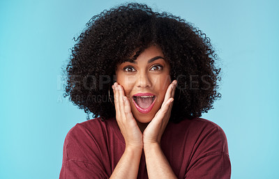 Buy stock photo Studio shot of an attractive young woman looking shocked against a blue background