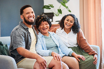 Buy stock photo Shot of a young man and woman relaxing with their elderly relative on the sofa at home