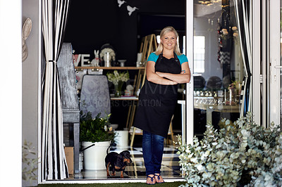 Buy stock photo Full length portrait of an attractive young woman standing with her arms crossed in the doorway to her flower store