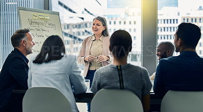 Buy stock photo Shot of a mature businesswoman giving a training presentation