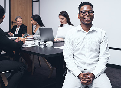 Buy stock photo Shot of a young businessman during a brainstorming session at work