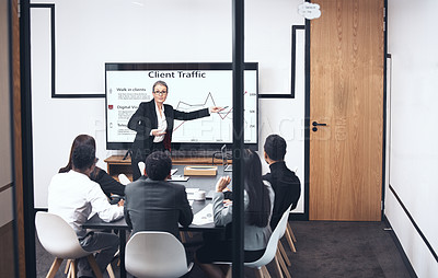Buy stock photo Shot of a mature businesswoman giving a presentation at work