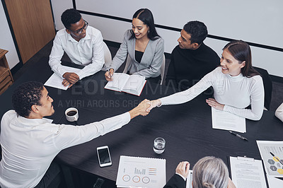 Buy stock photo Shot of two business colleagues shaking hands in greeting