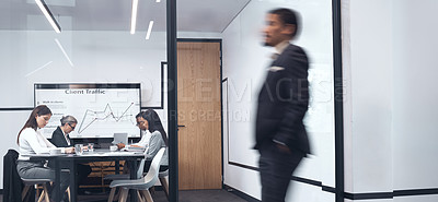 Buy stock photo Shot of a businessman walking through his office