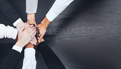 Buy stock photo Shot of a group of coworkers with their hands stacked