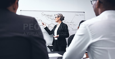 Buy stock photo Shot of a mature businesswoman giving a training presentation during a workshop