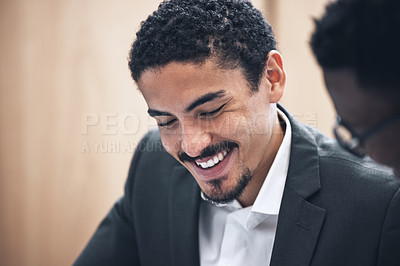 Buy stock photo Shot of a businessman sitting with his coworker