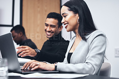 Buy stock photo Shot of a young businesswoman using a laptop while working