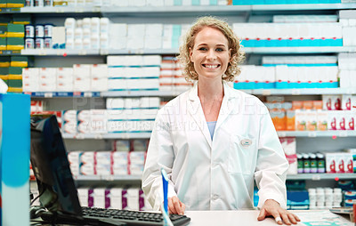 Buy stock photo Cropped portrait of an attractive young female pharmacist working in a drugstore