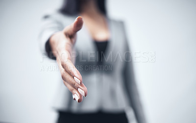 Buy stock photo Shot of a businesswoman holding out her hand for a handshake