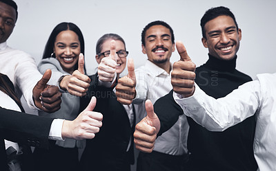 Buy stock photo Shot of a group of businesspeople together with their thumbs up