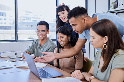 Buy stock photo Shot of a group of young people having a discussion in an office