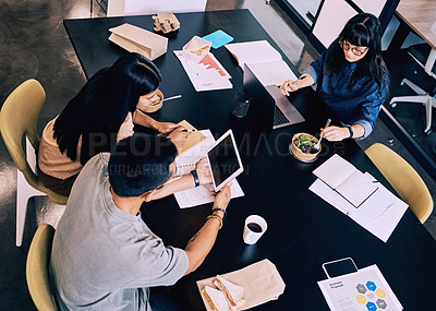 Buy stock photo Shot of a group of people eating and working together
