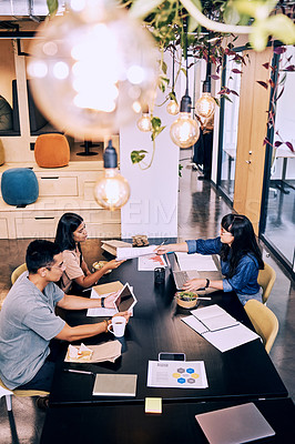 Buy stock photo Shot of a group of creatives eating and working together