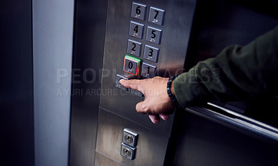 Buy stock photo Shot of an unrecognizable man pressing a button in an elevator