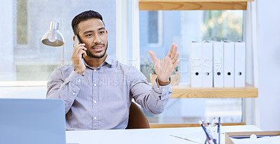 Buy stock photo Shot of a businessman talking on his cellphone while sitting at his desk