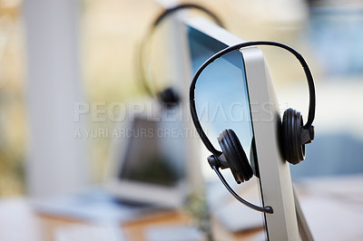 Buy stock photo Shot of call center equipment in an empty office
