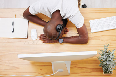 Buy stock photo Shot of a young businessman taking a nap at his desk