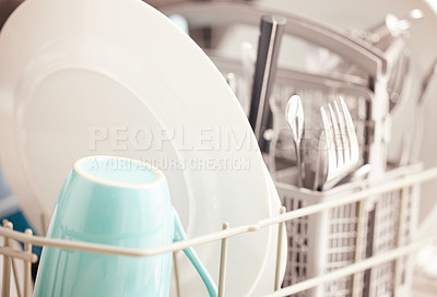 Buy stock photo Cropped shot of clean dishes in a dishwasher