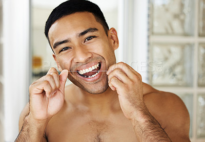 Buy stock photo Closeup shot of a handsome young man applying moisturiser to his skin